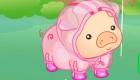 Juego de vestir de lluvia con un cerdo